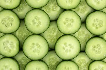 Fresh cucumber slices background.