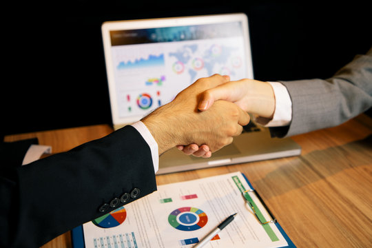 business person shaking hands.