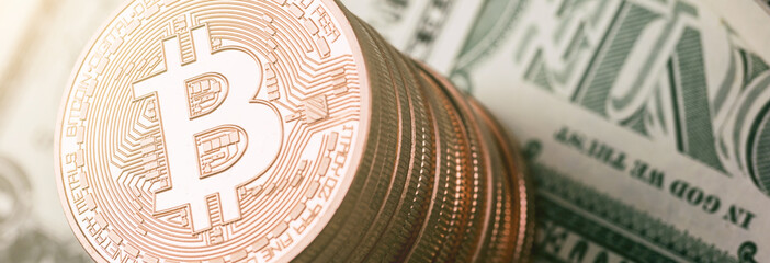 Bitcoin (BTC) cryptocurrency on dollar notes, digital money