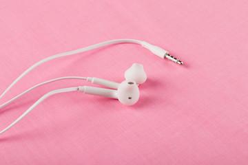 earphones on pink background
