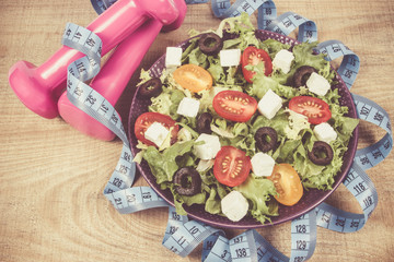 Greek salad with fresh vegetables, feta cheese and black olives.