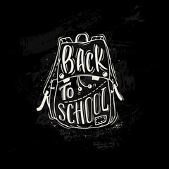 Back to school. School bag with hand-drawn lettering and ink splashes on black background. Imitation of chalk drawing on the blackboard. Vector illustration.