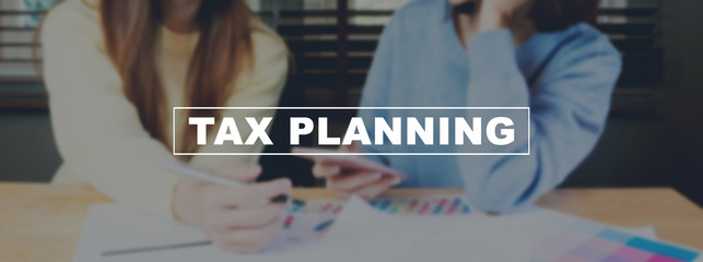 Text Tax planning on background women are working on smartphone. The concept of working with a lot of information.