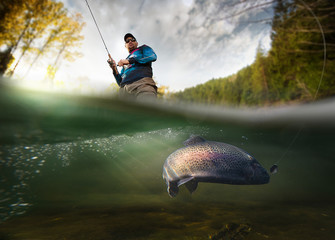 Ingelijste posters Vissen Fishing. Fisherman and trout, underwater view