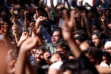 People shout slogans during the funeral of Shabir Ahmad Mir, a suspected militant who according to local media was killed in a gunbattle with Indian security forces at Tahab village of Pulwama district, in Mahind