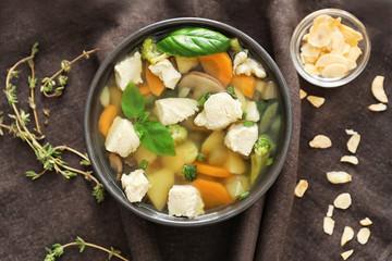 Bowl with delicious turkey soup on napkin