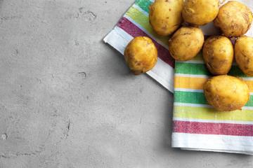 Raw organic potato on grey background
