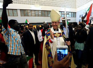 Archbishop of Canterbury Justin Welby waves to followers as he arrives for the inauguration of the 39th Province of the Anglican Communion in Khartoum
