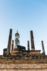 Buddha statue at wat mahathat temple in sukhothai historical park thailand