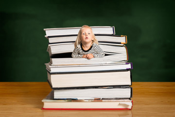 Girl popping out of the pile of books