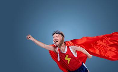 A funny superhero flies. Concept humor hero.