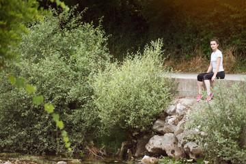 Focused Female Runner Resting