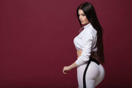 A big woman booty in leggings on red background