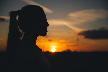 Silhouette of a woman with evening sky