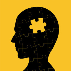 Icon of human head with piece of puzzle