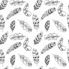 Beautiful seamless pattern with feathers in boho style in black and white colors. Sketch vector illustration. Native American, ethnic background