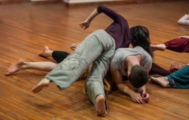 dancers contact, on floor