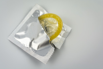 Condom close-up isolated. Contraceptive protection from pregnancy, AIDS.