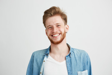 Portrait of young handsome hipster man with beard smiling laughing looking at camera over white background. Wall mural