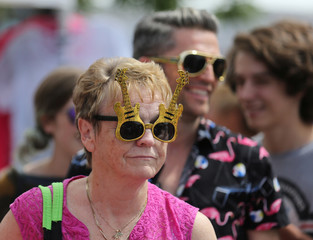 A woman wears souvenir sunglasses during the Collingwood Elvis Festival in Ontario