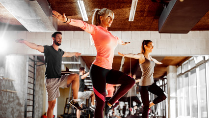 Group of energy people exercising in the gym.