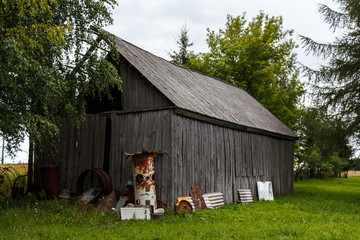 Old abandoned wooden barn in the countryside of Latvia