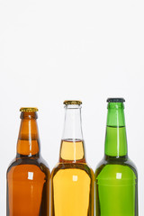 Set of bottles with beer. Cropped image of several bottles of alcoholic beverage.
