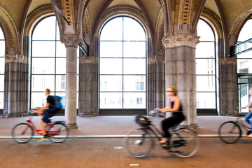 Moving cyclist along street in Amsterdam