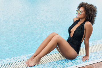 Happy youthful african girl relaxing on summer resort