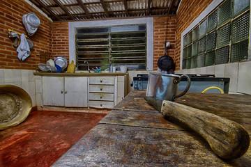 Aluminum mug in an old farm kitchen photo