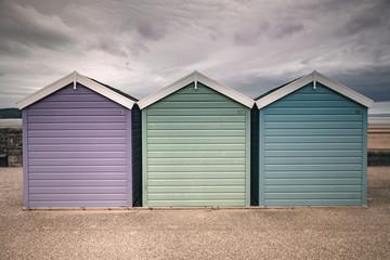 Beach Huts Purple Green and Blue Grey Sky Weston Super Mare