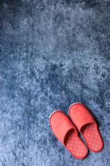 red slipper shoe on blue carpet floor softness mat