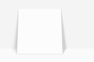 White paper square banner with drop shadow leaning with the white abstract wall background in empty room studio. gradient used for background with space for your text ,display picture of your product.