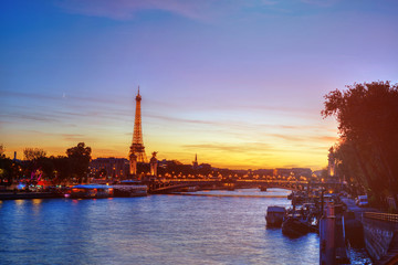 Eiffel Tower and Seine river at night