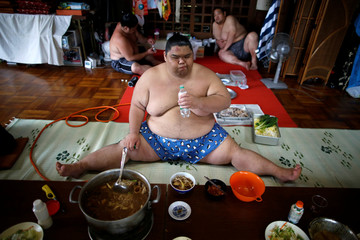 "QUALITY REPEAT Sumo wrestler Kaiho eats a ""chanko"" meal in the main hall of Ganjoji Yakushido temple, in Nagoya"