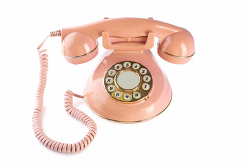 Pink retro telephone isolated on a white