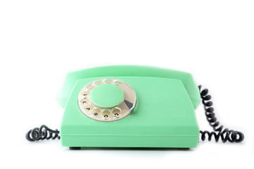 Green retro telephone isolated on a white