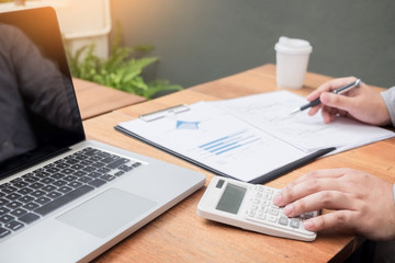 Administrator business man financial inspector and secretary making report, calculating or checking balance. Internal Revenue Service inspector checking document. Audit concept
