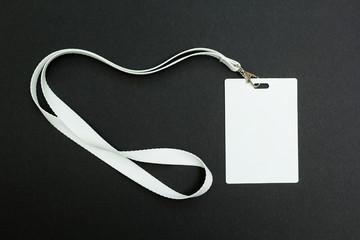 Blank badge with lanyard on black background