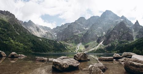 Fototapeta Beautiful panoramic view of mountain lake Morskie oko with stones at foreground obraz