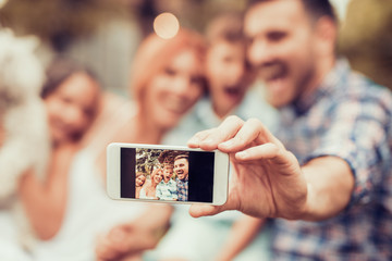 Family taking picture of themselves