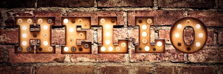 Hello - retro bulb letters on a brick wall