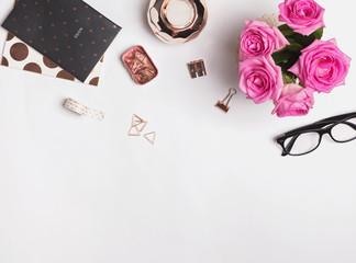 Stylish rose gold accessories, glasses and roses