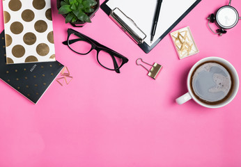 Woman's accessories and cute stationery on pink background