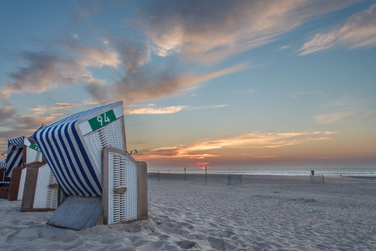 Beach chair in the sunset on the island of Norderney in the German North Sea