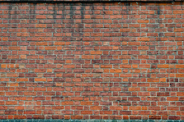 Old and grungy red brick wall background