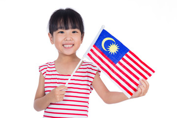 Asian chinese little girl holding Malaysian Flag in isolated white background