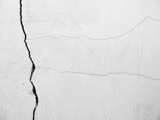 old white wall with cracks
