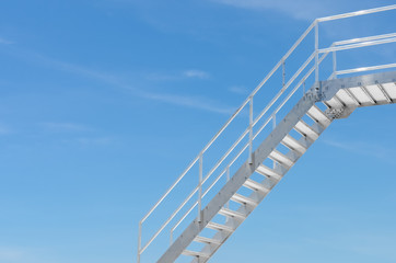 Copy space of iron stairs on blue sky and white clouds background.