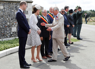 Britain's Prince Charles greets Prince William and Catherine the Duchess of Cambridge as he arrives at Tyne Cot cemetery for commemorations for the 100th anniversary of the battle of Passchendaele near Ypres in Belgium
